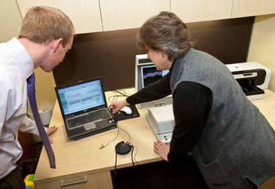 two audiologists using state-of-the-art hearing technology